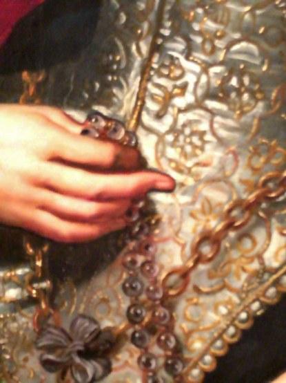 Detall retrat de Rubens d'una dona jove amb rosari